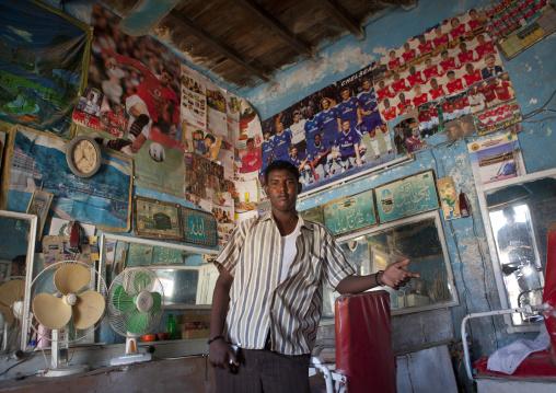 A barber inside his barbershop local, Berbera, Somaliland