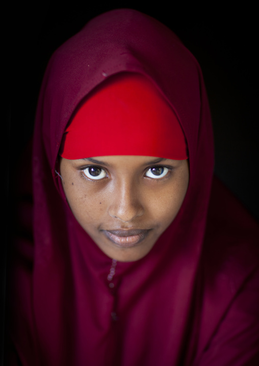 Portrait of a young woman wearing a red veil, Berbera, Somaliland