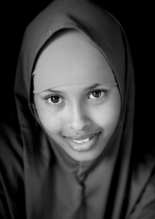 Close up black and white portrait of a smiling young woman, Berbera, Somaliland