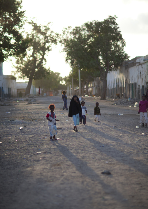 Children Playing In A Clay Ground Street At Sunset, Berbera, Somaliland
