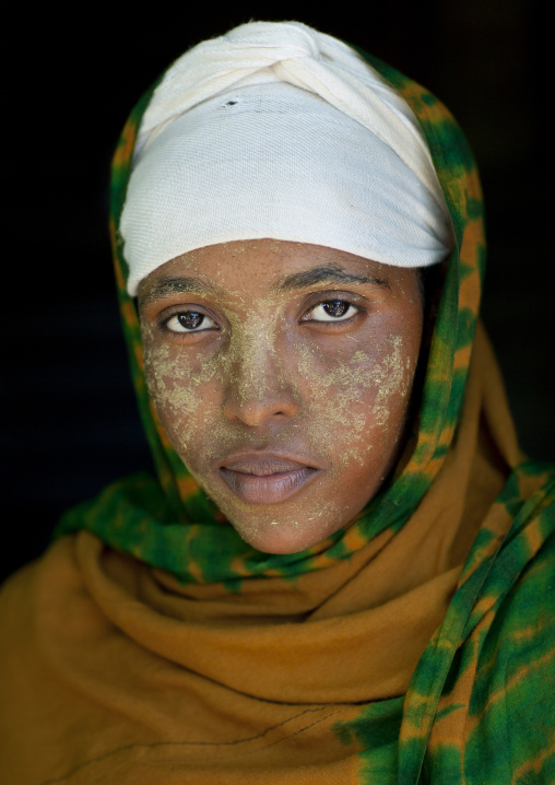 Portrait of a young woman wearing qasil on her face, Lasadacwo village, Somaliland