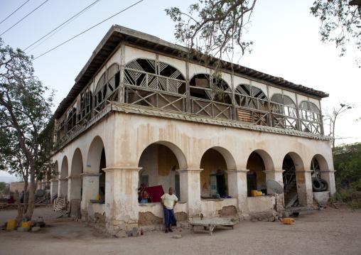 A man outside a former ottoman empire house, Berbera area, Somaliland