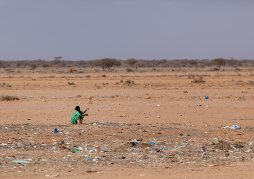 Somali woman collecting rubbishes to sell, Togdheer region, Burao, Somaliland