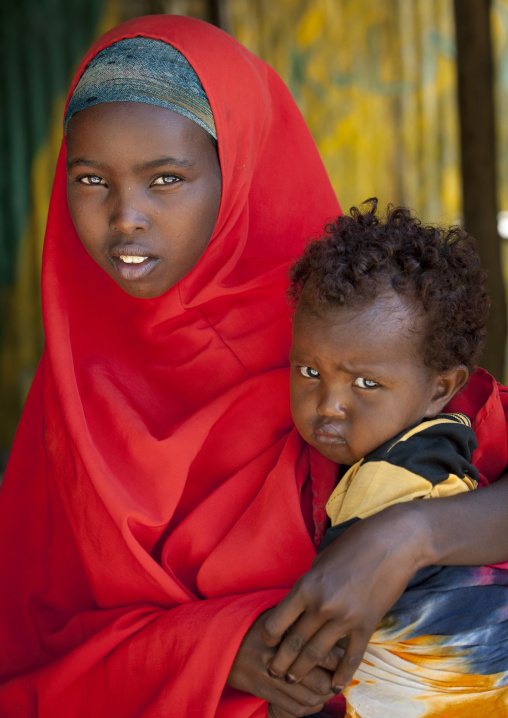 Portrait of a young girl holding a small child, Burao, Somaliland
