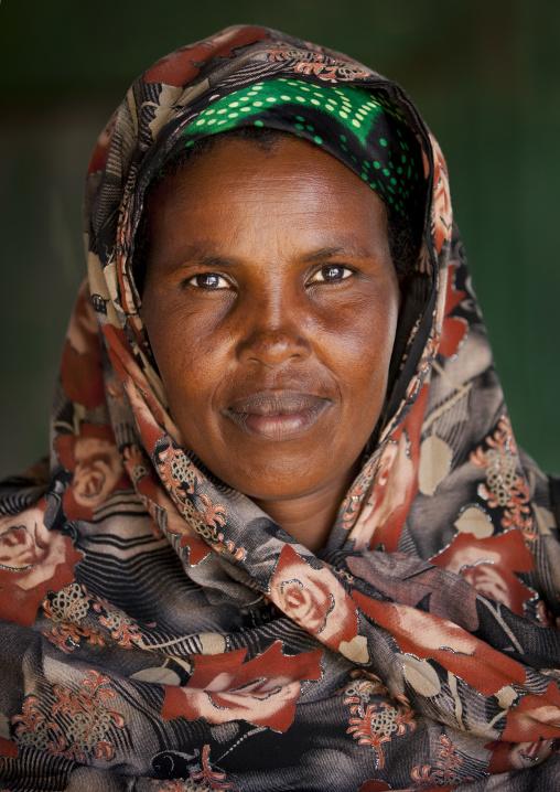 Portrait of a beautiful mature woman wearing a colorful hijab, Burao, Somaliland