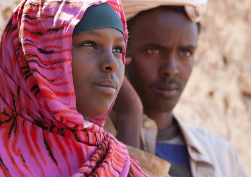 Portrait of cute pink veiled smiling teenage girl,  Degehabur, Somaliland