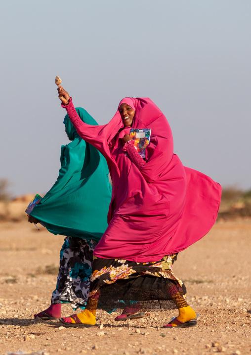 Somali teenage girl eating an ice cream in the street, Woqooyi galbeed province, Baligubadle, Somaliland