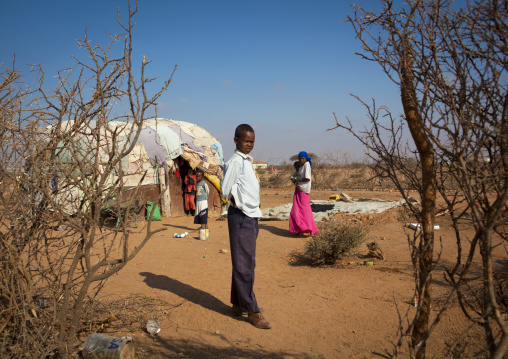 A family outside their slum hut, Baligubadle, Somaliland