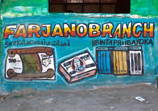 Painted bilboard advertisement for money transfer, Woqooyi galbeed region, Hargeisa, Somaliland