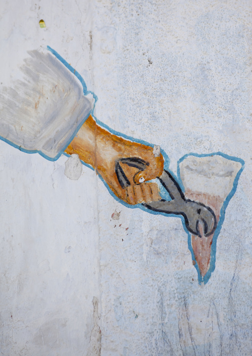 A painted sign advertising for a dentist depicting a tooth removal, Boorama, Somaliland