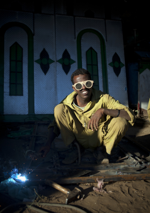 Portrait of a soldering man wearing yellow protection sunglasses, Boorama, Somaliland