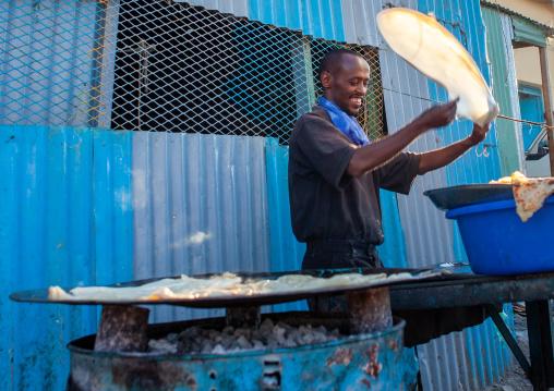 Somali man making somali flatbread in the street, Woqooyi galbeed region, Hargeisa, Somaliland