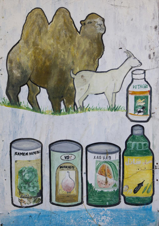 Painted bilboard advertising for dairy products depicting products and livestock, Boorama, Somaliland