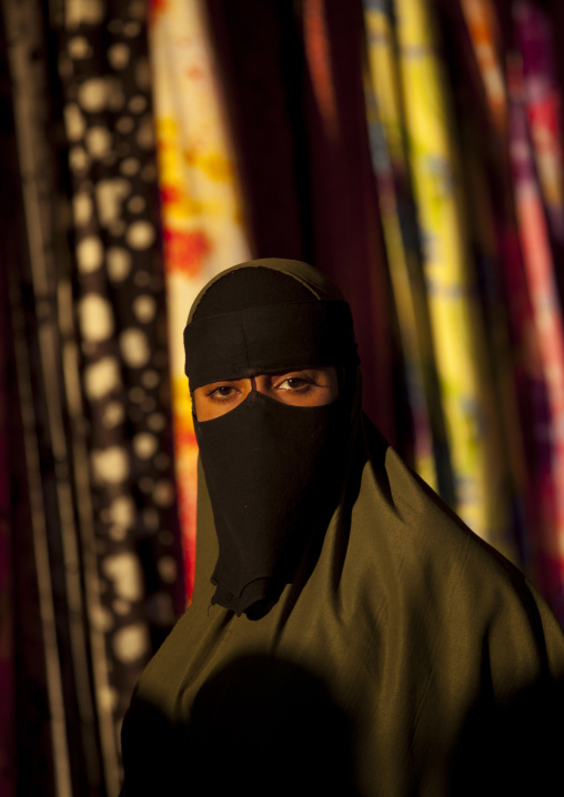 Portrait of a woman wearing a black niqab, Boorama, Somaliland