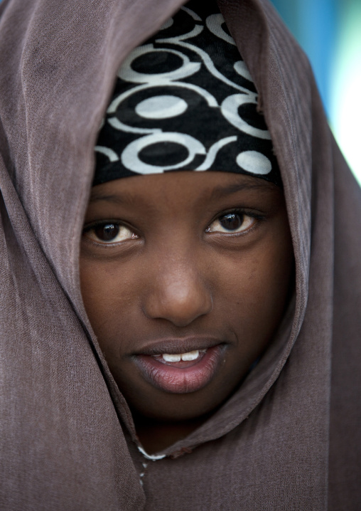 Portrait of a timid smiling young girl wearing a  brown veil, Boorama, Somaliland