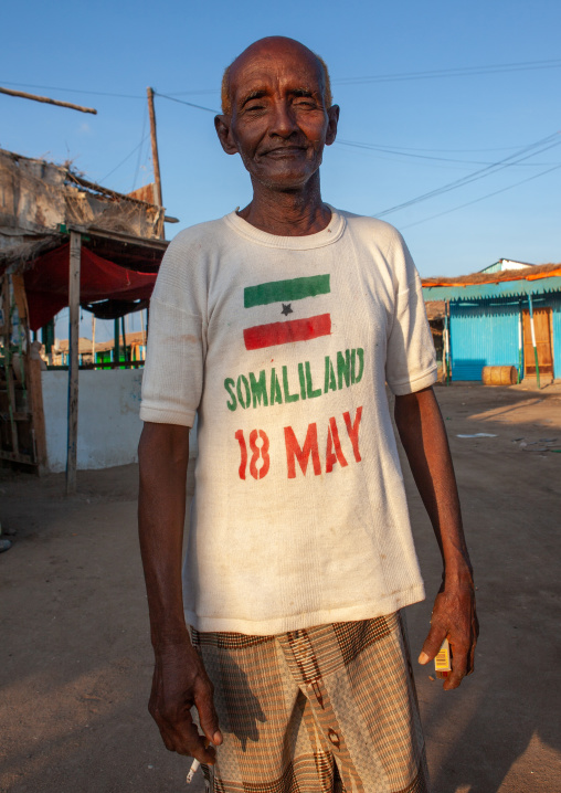 Old somali man wearing a shirt for the national day, Awdal region, Zeila, Somaliland