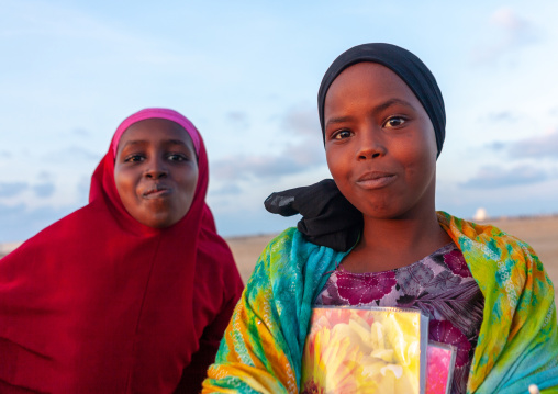 Portrait of somal girls with a school books, Awdal region, Zeila, Somaliland