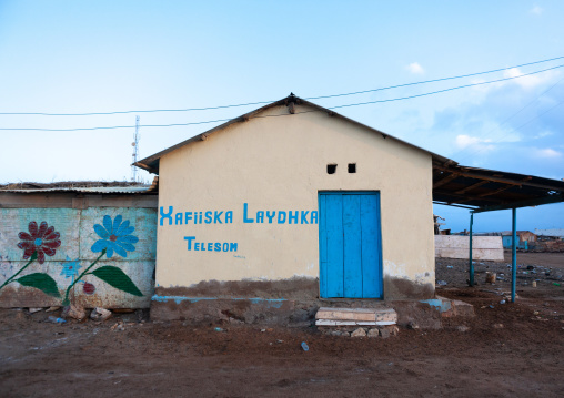 Advertisement for telesom on the wall of a modern house, Awdal region, Zeila, Somaliland