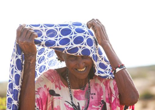 Old somali woman adjusting her hijab, Awdal region, Zeila, Somaliland