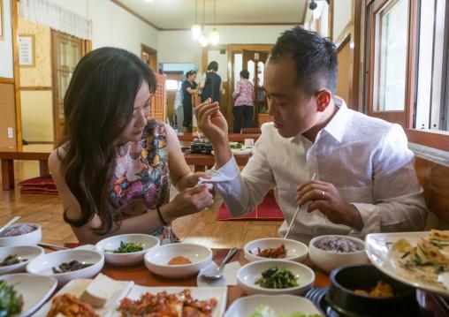North korean defector joseph park eating at restaurant with his south korean fiancee juyeon, National capital area, Seoul, South korea
