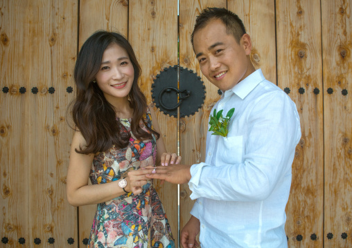 North korean defector joseph park putting wedding ring on the finger of his south korean fiancee juyeon, Sudogwon, Paju, South korea