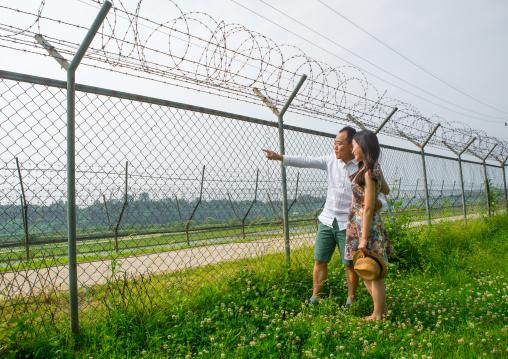 North korean defector joseph park with his south korean fiancee juyeon on the north and south korea border, Sudogwon, Paju, South korea