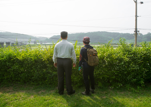 South korean couple in front of freedom and railway bridge over imjin river between north and south korea, Sudogwon, Paju, South korea
