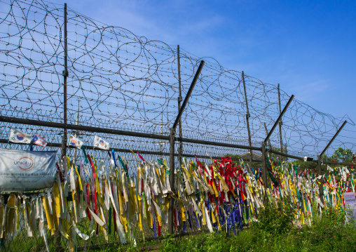 Messages of peace and unity written on ribbons left on fence at dmz, Sudogwon, Paju, South korea