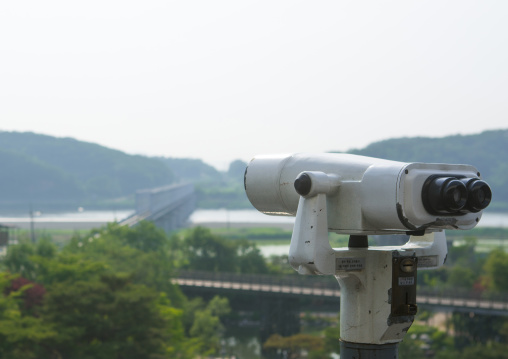 Binoculars in front of freedom and railway bridge over imjin river between north and south korea, Sudogwon, Paju, South korea