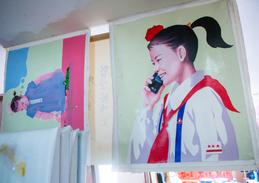Sun mu artist painting of a north korean girl calling on a mobile phone, National capital area, Seoul, South korea