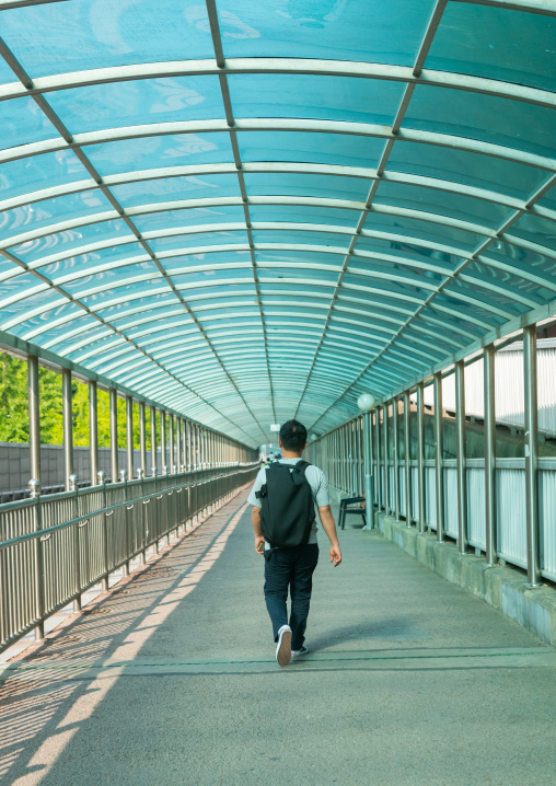 North korean defector joseph park coming back nine years after in yangcheong in a glass corridor, National capital area, Seoul, South korea