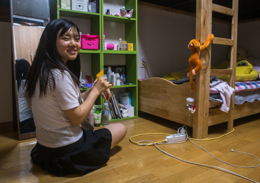 North korean teen defector in her bedroom, National capital area, Seoul, South korea