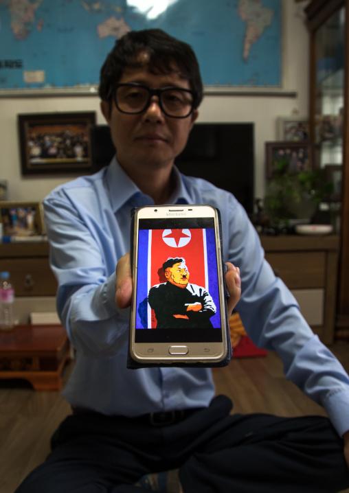 Former north Korea propaganda artist called Song Byeok showing a portrait of kim jong looking like Hitler, National Capital Area, Seoul, South Korea