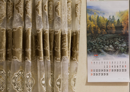 North Korean calendar and curtain during the exhibition Pyongyang sallim at architecture biennale showing a north Korean apartment replica, National Capital Area, Seoul, South Korea