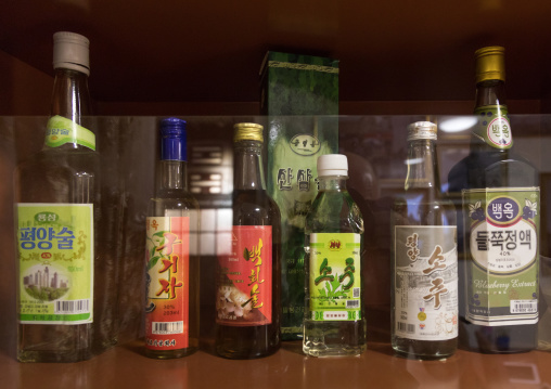 Alcohol bottles during the exhibition Pyongyang sallim at architecture biennale showing a north Korean apartment replica, National Capital Area, Seoul, South Korea