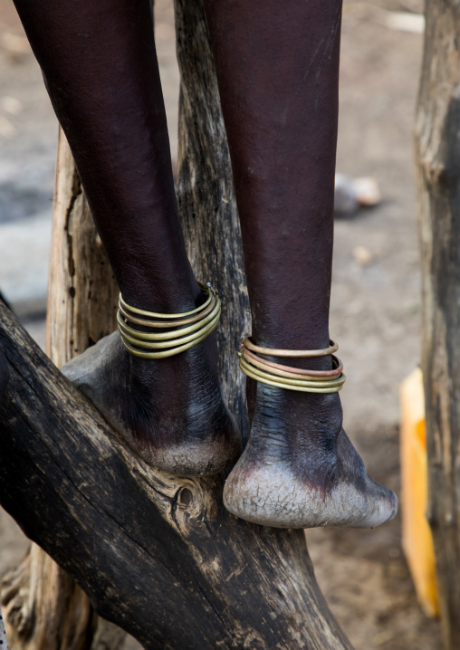 Anklets on the legs of a Toposa tribe girl, Namorunyang State, Kapoeta, South Sudan