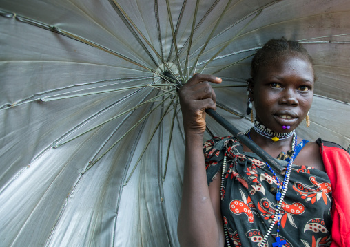 Portrait of a Toposa tribe woman with an umbrella, Namorunyang State, Kapoeta, South Sudan