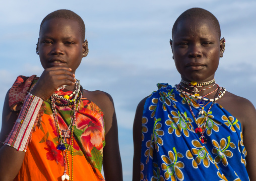 Toposa tribe young women in traditional clothing, Namorunyang State, Kapoeta, South Sudan