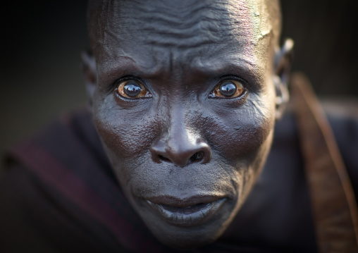 Portrait of a Toposa tribe man with shocked big eyes, Namorunyang State, Kapoeta, South Sudan