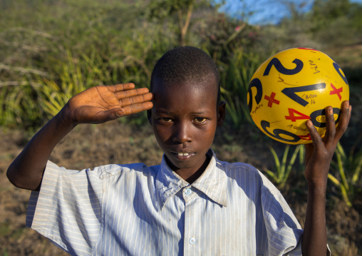 Portrait of a Larim tribe boy saluting with the hand, Boya Mountains, Imatong, South Sudan
