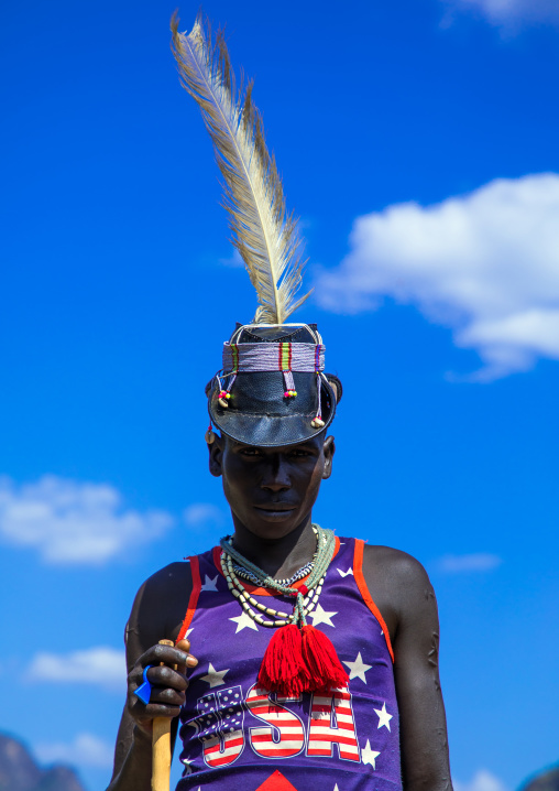 Larim tribe man with american tshirt and a hat, Boya Mountains, Imatong, South Sudan