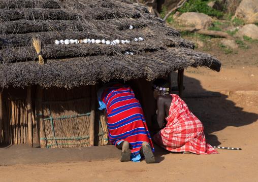 Women entering in a Larim tribe house, Boya Mountains, Imatong, South Sudan