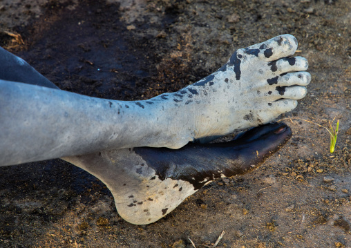 Mundari tribe man feet covered in ash, Central Equatoria, Terekeka, South Sudan