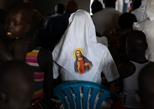 Mundari tribe nun with jesus christ on her veil during a sunday mass in a church, Central Equatoria, Terekeka, South Sudan