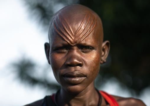 Portrait of a Mundari tribe woman with scarifications on the forehead, Central Equatoria, Terekeka, South Sudan