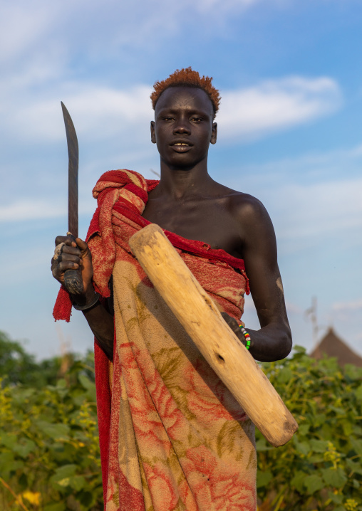 Portrait of a Mundari tribe man with hair dyed in orange with cow urine, Central Equatoria, Terekeka, South Sudan