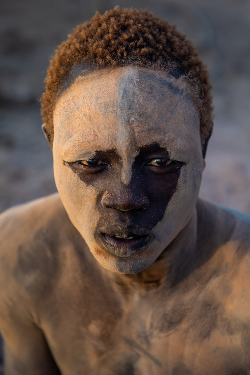 Mundari tribe man covered in ash to repel flies and mosquitoes, Central Equatoria, Terekeka, South Sudan