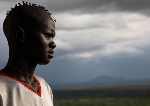 Lotuko tribe man with a special hairstyle, Central Equatoria, Illeu, South Sudan