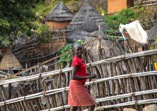 Girl in a Lotuko tribe village with thatched houses, Central Equatoria, Illeu, South Sudan