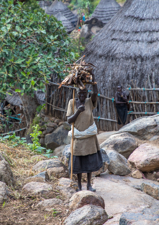 Lotuko tribe woman carrying wood on her head, Central Equatoria, Illeu, South Sudan